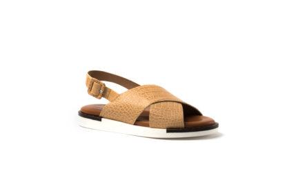 Bequeme Sandale mit Krokoprägung und weißer Sohle.