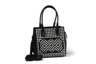 Schicke Lederhandtasche geflochten in Schwarz/weiß.