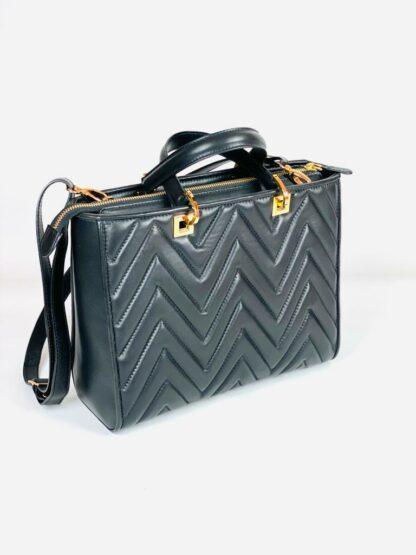 Kurzhenkeltasche mit Riemen Nappastepp in schwarz 28x22 cm.